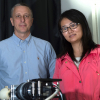 Researchers Tomasz Tkaczyk and Ye Wang, who earned her doctorate this year at Rice, led the development of a portable spectrometer able to capture far more data much quicker than other fiber-based systems. The TuLIPSS camera will be useful for quick analysis of environmental and biological data. Photo by Jeff Fitlow