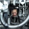 Photo of Professor Aleksander Jablonski looking through a gap in the instrument