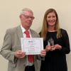 Photo of John Chalmers receiving the Award from Karen Faulds